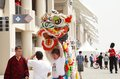 Chinese lion dance troupe entertaining people f bahrain shakir april at formula village vending area entertainment in formula gulf Stock Photos