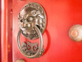 Chinese lion head door knocker on red door Royalty Free Stock Photo