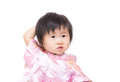 Chinese little girl scratch her head isolated on white Royalty Free Stock Images