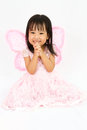 Chinese little girl wearing butterfly custome with praying gestu Royalty Free Stock Photo