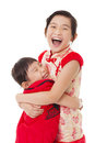 Chinese little girls and giving one another hug happy Stock Photo