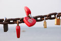 Chinese love locks on a rusty chain Stock Photo