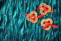 Chinese lucky coins background with three sets of three each tied with red ribbon on turquoise velvet fabric one set of Royalty Free Stock Photos