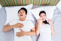 Chinese man snoring keeping his wife awake Royalty Free Stock Photo