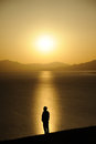 Chinese man at sunrise standing on the lakeside Royalty Free Stock Photos