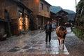 Chinese Miao nationality farmer with buffalo
