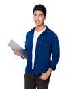 Chinese mixed iranian man hold with laptop computer Royalty Free Stock Photo