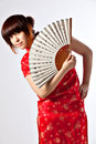 Chinese model in traditional cheongsam dress with slit holding fan asian cute girl young model with a veriety of facial Stock Photography