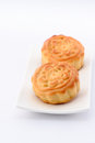 Chinese moon cake -- food for Chinese mid-autumn festival on white plate isolated on white background