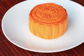 Chinese moon cake on white dish tradition the pattern on is not a logo or trademark Royalty Free Stock Images