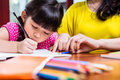 Chinese mother homeschooling her child Royalty Free Stock Photo
