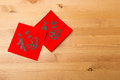 Chinese new year calligraphy word meaning is good luck over the wooden background Stock Photos