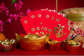 Chinese new year festival decorations ang pow or red packet and gold ingots photo Royalty Free Stock Photography