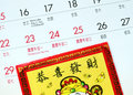 Chinese new year marked on the calendar and a red lucky money envelope Royalty Free Stock Photos