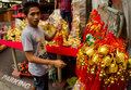 Chinese new year metro manila philippines january street vendor preparing his display of lucky charms a week before the annual Royalty Free Stock Image