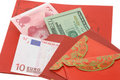Chinese New Year red packets and currency notes Royalty Free Stock Photo