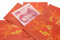 Chinese New Year red packets and Renminbi Royalty Free Stock Images
