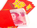 Chinese new year red packets and renminbi currency on white background Royalty Free Stock Photo