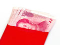 Chinese new year red packets and renminbi currency on white background Royalty Free Stock Photos