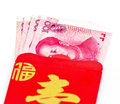 Chinese new year red packets and renminbi currency on white background Stock Images