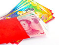 Chinese new year red packets and renminbi currency on white background Stock Photo