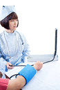 Chinese nurses in blood pressure measurement Stock Photos
