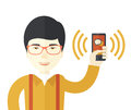 Chinese Office worker and his smartphone Royalty Free Stock Photo