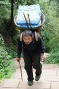 Chinese old man carry bottled water Stock Photo