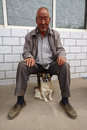 A Chinese old man and his dog