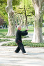 A chinese old man in the west lake beside tai chi hangzhou april hangzhou china it is martial art practiced both Royalty Free Stock Photo