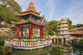Chinese pagoda and pavilion by the lake singapore february at haw par villa theme park this theme park contains over statues Stock Image