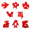Chinese paper cutting set a of traditional china cuts in bright red color with designs in cute animals for children such as birds Stock Image