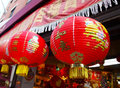 Chinese paper globe lanterns a few brightly decorated red hang in the front of a souvenir shop in chinatown nyc Stock Photography