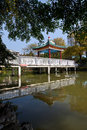 Chinese pavilion bridge in lake Royalty Free Stock Photo