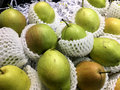Chinese pear in white plastic package Royalty Free Stock Photo
