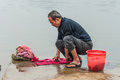 Chinese peasant man washes in the river, China