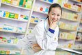 Chinese pharmacy chemist woman in china drugstore cheerful pharmacist standing Royalty Free Stock Images