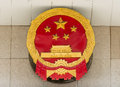 Chinese political party emblem in front of official building in shanghai popular republic of china Royalty Free Stock Photos