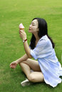 Chinese Portrait of young happy woman eating ice-cream Royalty Free Stock Photo