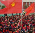 Chinese Primary School Students Participate in Young Pioneer Ceremony