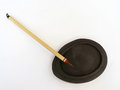 Chinese red painting brush on ink well a photograph showing a single tip bamboo for resting a black stone inkwell taken clean Royalty Free Stock Image
