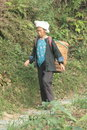 Chinese rural resident. Guilin Yangshuo. peasant woman with basket