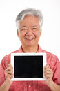Chinese Senior Man Holding Digital Tablet Stock Photos