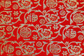 Chinese shiny ornament on red fabric Stock Photo