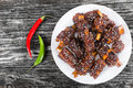 Chinese spicy Spare Ribs on white dish sprinkled with sesame Royalty Free Stock Photo