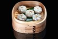 Chinese steamed dim sum in bamboo basket Royalty Free Stock Photo