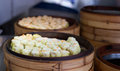 Chinese steamed dimsum in bamboo containers traditional cuisine Stock Photos