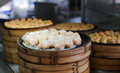 Chinese steamed dimsum in bamboo containers traditional cuisine Royalty Free Stock Images