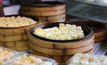 Chinese steamed dimsum in bamboo containers traditional cuisine Stock Images