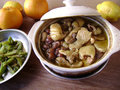 Chinese stew traditional chicken in white crock pot ready to serve Royalty Free Stock Photography